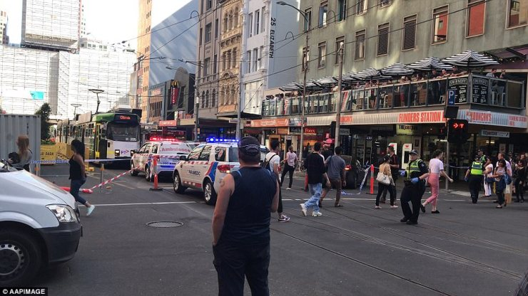 Police said the driver of the car and a second man were arrested after what they believe was a 'deliberate' attack in the CBD