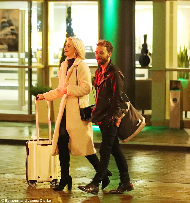In the Christmas spirit: The couple were beaming with glee as they headed back to their hotel, with Hanni looking chic in a thick cream coat