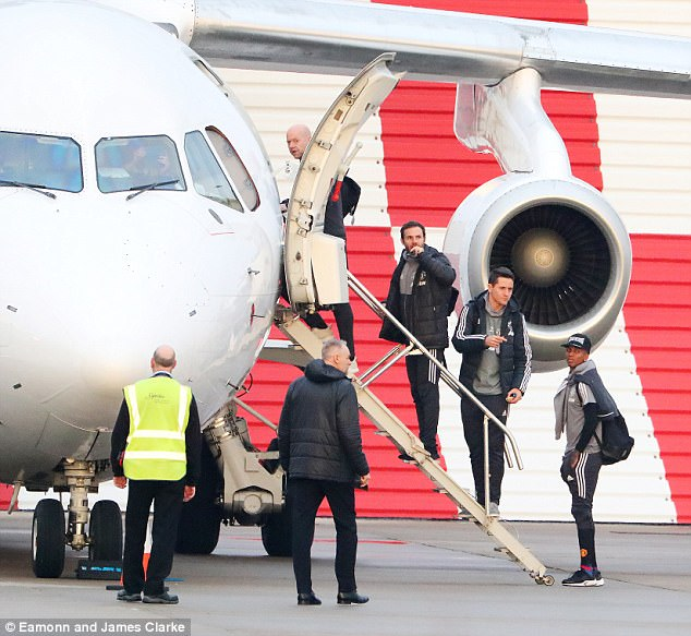 Ashley Young, Ander Herrera and Juan Mata all wrap up as they make their way to Leicester