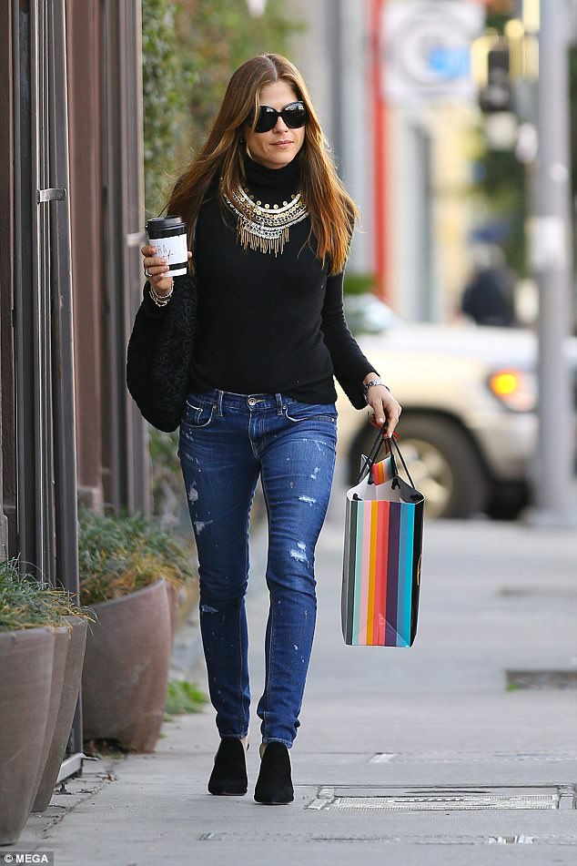 Coffee break: The actress carried her beverage as she braved the chilly weather