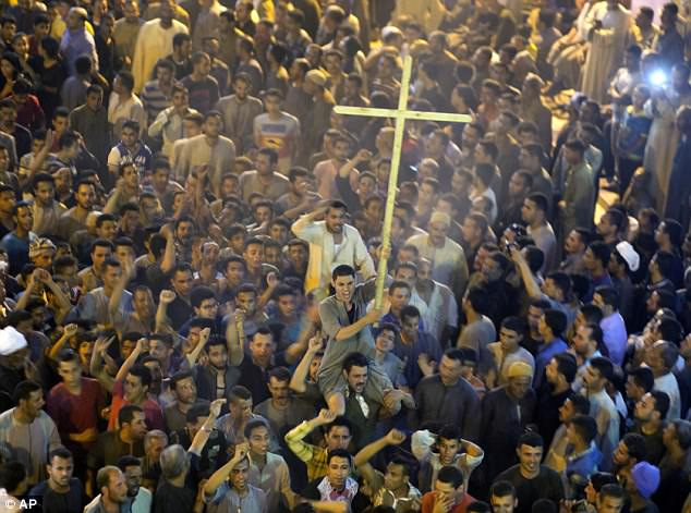 Christians constitute 10 percent of Egypt's mostly Muslim population. Followers of the religion are seen shouting slogans after a funeral service for victims of a bus attack in May (stock photo)