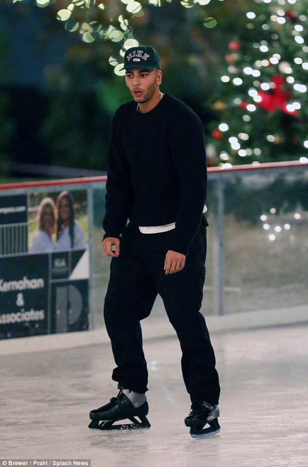 Iced: Kourtney's boyfriend Younes Bendjima, 24, skated closely beside his lady love wearing a dark sweater and matching sweat pants