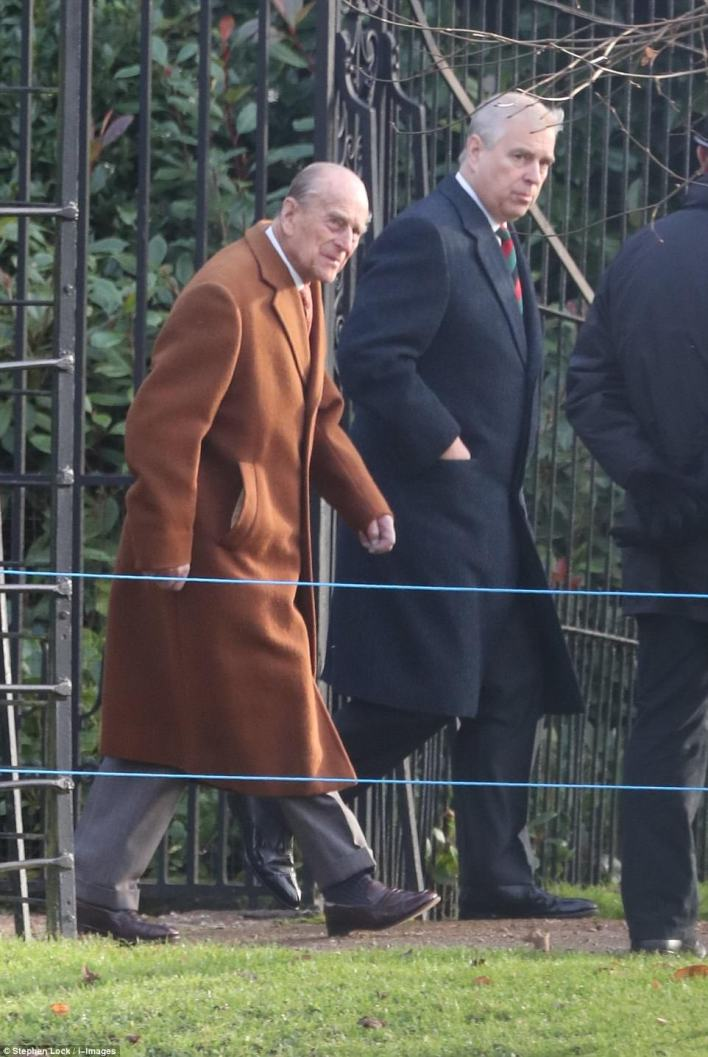 Prince Philip, wearing a warm brown wool coat arrives for the church service at St. Mary Magdalene Church on the royal Sandringham estate this morning. Prince Andrew walked closely beside his father as they made their way to the traditional service