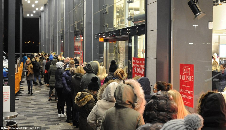 People queued up through the night with security guards on duty from 3am to coordinate crowds lining up for the famous Next Boxing Day Sale. Here they wait eagerly outside the Silverlink Retail Park in North Tyneside