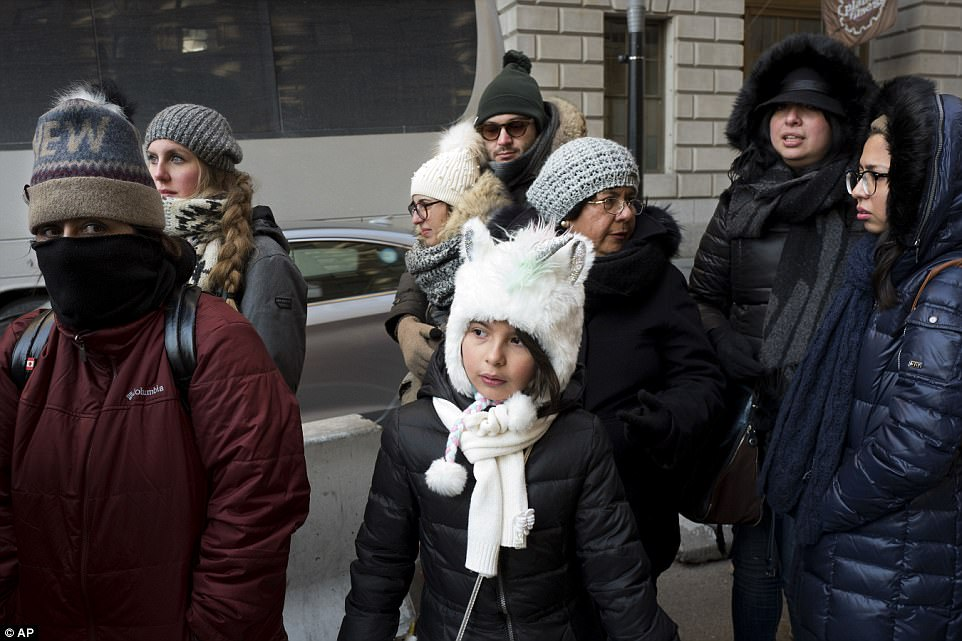 People are all bundled up as they brave the frigid temperatures to walk in lower Manhattan on Wednesday