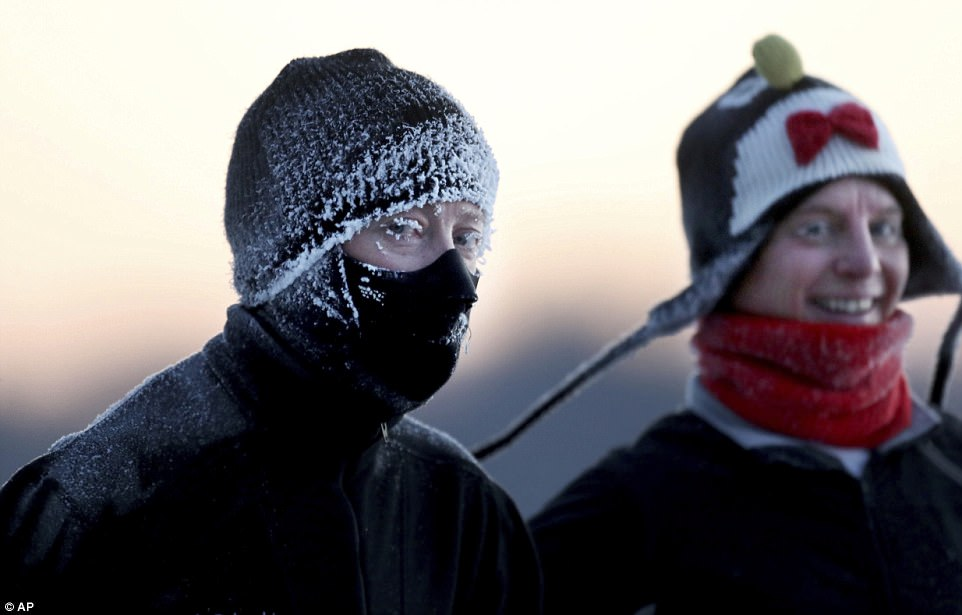 Kelly Richards, left, and Lisa Rippe, jog around Lake Harriet in the sub-zero temps Wednesday in Minneapolis