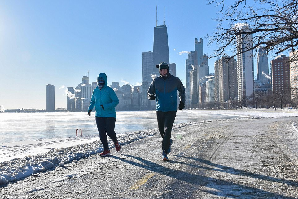 People went out for a run near North Avenue Beach in chilly Chicago on Wednesday morning, despite the freezing sub-zero temperatures