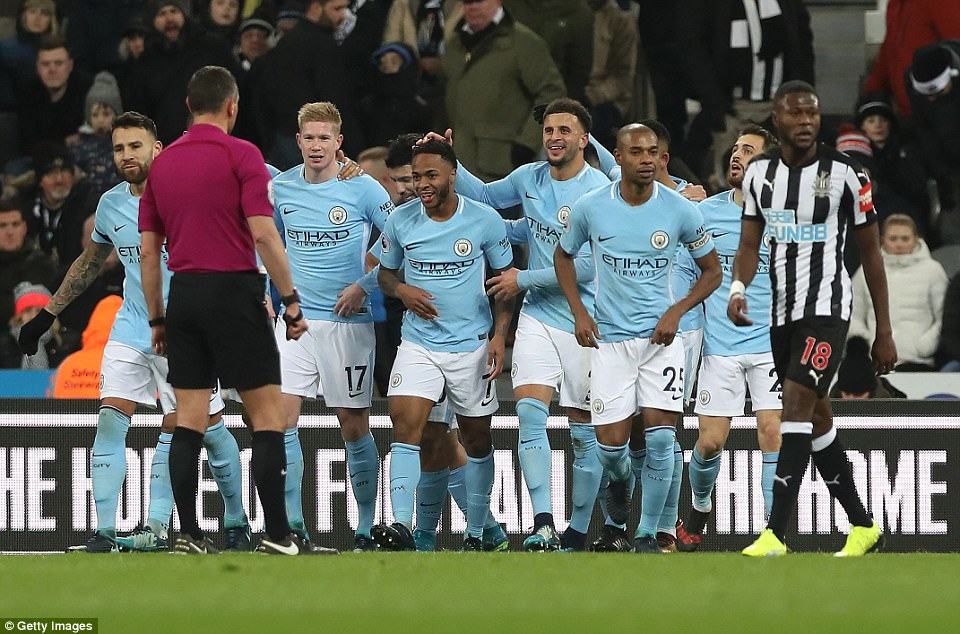 Sterling's Manchester City team-mates congratulate him after his 17th goal of the season put the away side in front