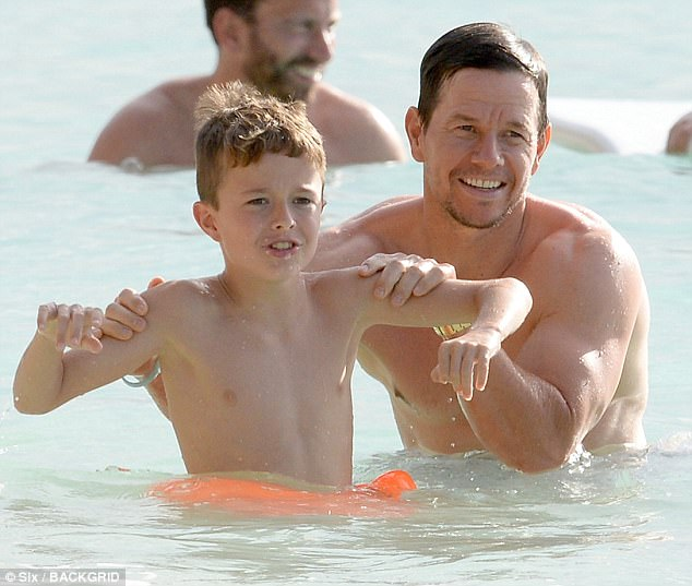 A chip of the ole block: Mark Wahlberg posed with his mini me son in Barbados on Friday
