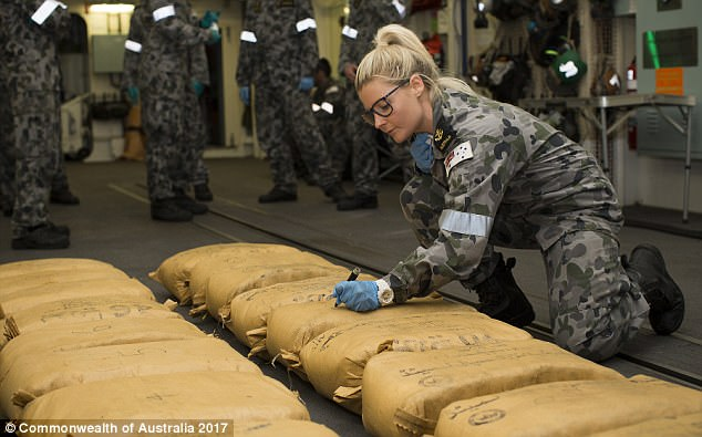 Heroin and hashish worth close to half a billion dollars has been seized by the Royal Australian Navy