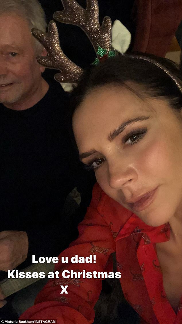 Family affair: Posh posed with her father Tony at the dinner table