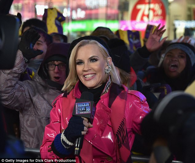 Celebrating a new year: The former actress wore a pink jacket and a black knotted beanie for her TV hosting gig. She also had on a black turtleneck sweater and finger-less mittens