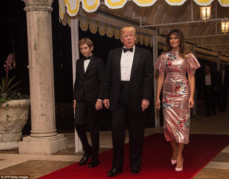 Melania donned a gorgeous $4,000 Emery floral-embroidered sequin dress, while the boys sported black tie