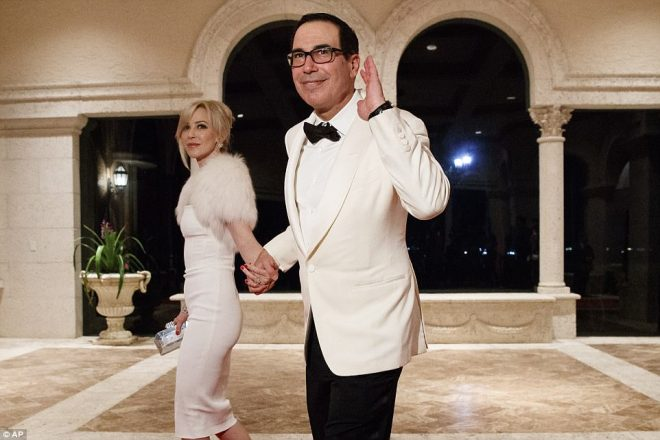 Treasury Secretary Steve Mnuchin and his wife Louise Linton arrive in all white for a New Year's Eve bash