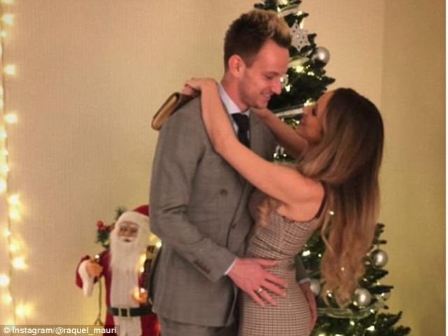 Barcelona midfielder Ivan Rakitic looks loved up with wife Raquel Mauri