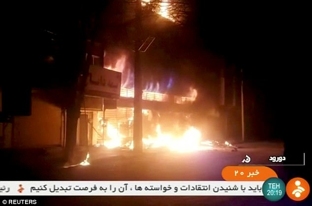 The death toll from violent protests in Iran has risen to 21 after nine more people were killed in clashes overnight. New pictures have emerged showing some of the unrest on New Year's Eve with a building on fire in Dorud