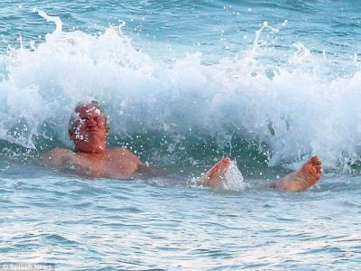 Seas the day!The Oscar-winning star seemed in good spirits, despite almost being wiped out by one particularly large wave