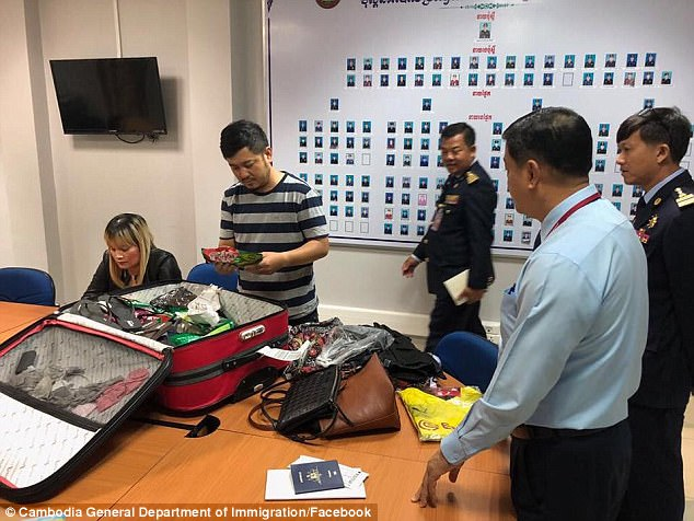 Cambodia's General Department of Immigration says on its official Facebook page that 1,814 grams of heroin were found embedded in the side of Ve Thi Tran's suitcase (pictured)