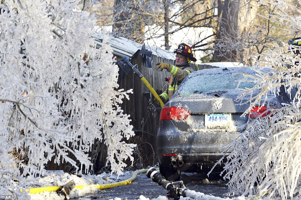 The extreme weather conditions has been tough on everyone, including firefighters. In this Jan. 5, 2018, file photo, a firefighter from the Longmeadow Fire Department battles a house fire in Longmeadow, Massachusetts