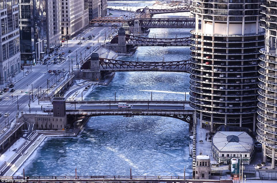 Illinois is firecasted to reach 29 degrees on Sunday. Pictured is a view of the frozen Chicago river on January 6, 2018