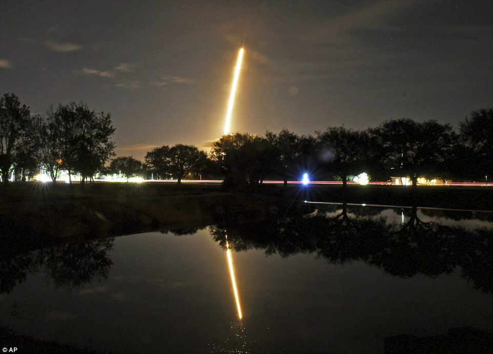 The launch is seen from Viera, Florida. SpaceX launched its mission - a secret satellite codenamed Zuma - at 8pm on Sunday