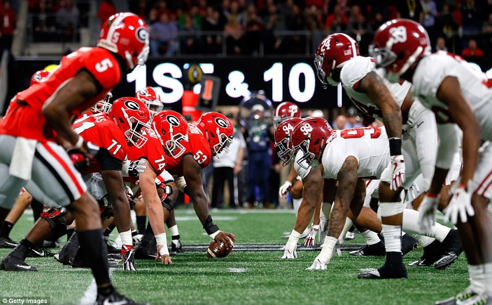 The Georgia Bulldogs line up against the Alabama Crimson Tide during the first quarter on Monday in Atlanta