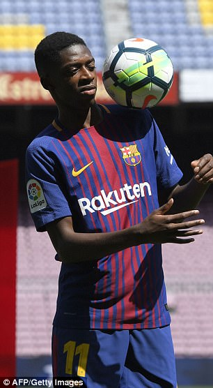 Dembele during his unveiling by the Spanish club