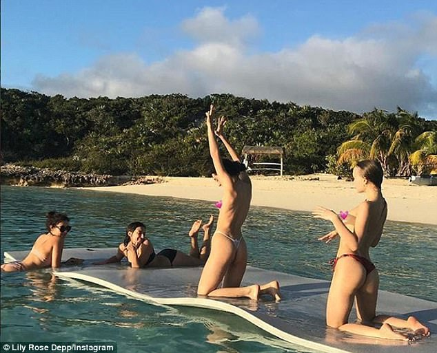 Baring all:Lily Rose Depp proved she certainly isn't shy as she shared a topless snap from her holiday with friends to Instagram on Tuesday