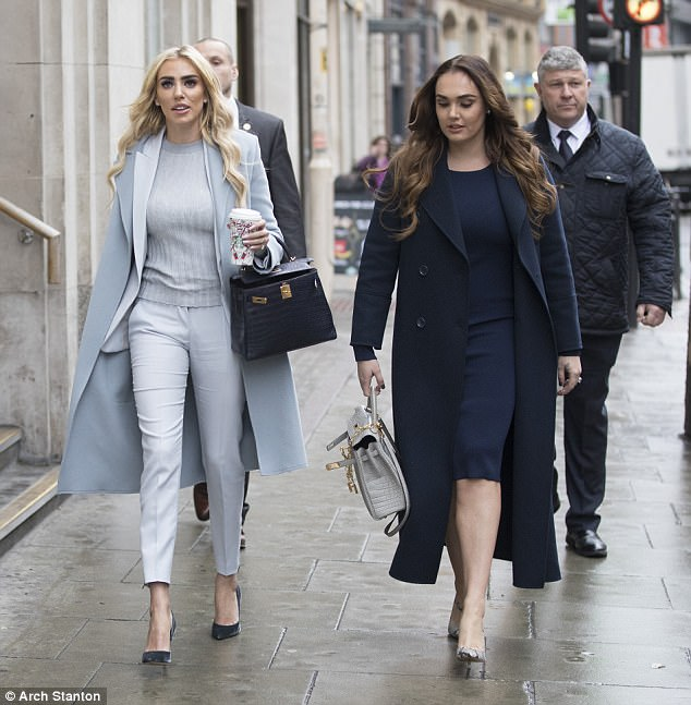 Petra Ecclestone was supported by her sister Tamara as she arrived at the High Court today