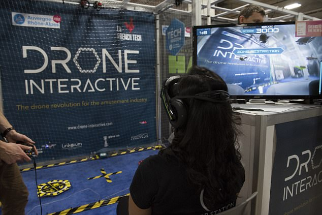Drone Interactive's system is designed to be used in arcades or other larger entertainment areas. It uses two small drones in a netted arena that can be operated using an Xbox controller