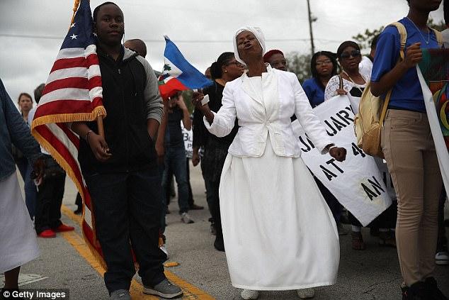 Jocelyne Pierre (center) participates in the commemoration in Miami