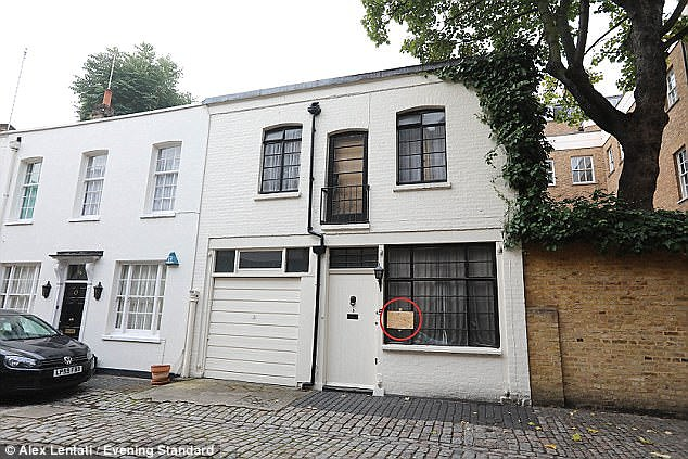 Police smashed a window (circled) to break into her terraced townhouse in London's Belgravia