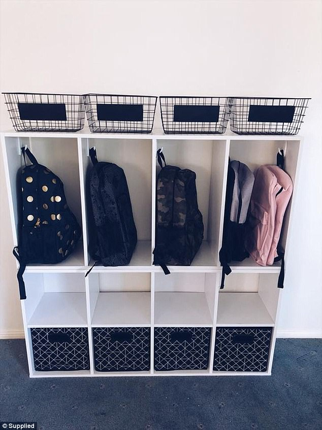 The school bag station is where each of her children hang there bags as well as store other items that they need for the next day