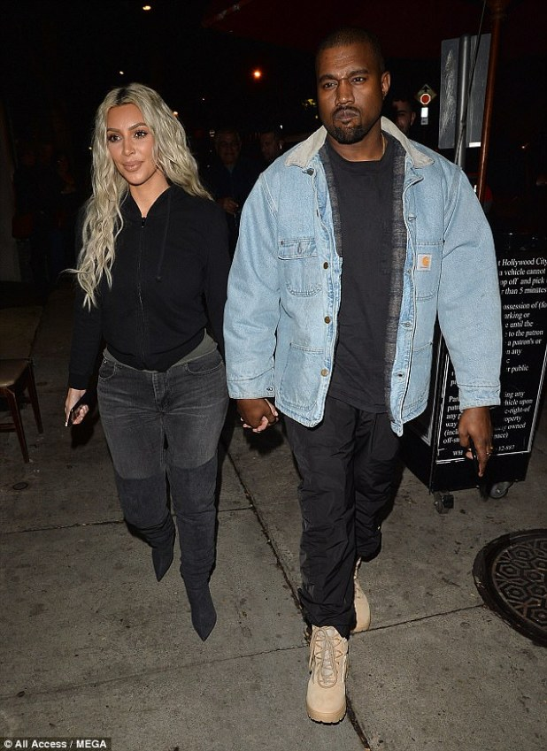 Baby number three: Kim Kardashian and Kanye West, pictured here over the weekend, have welcomed a girl