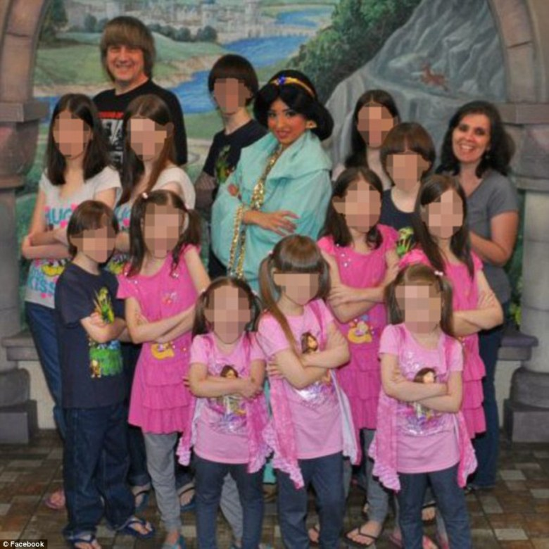 David and Louise are pictured above smiling with their children and Disney Princess Jasmine. The photo was posted in 2012