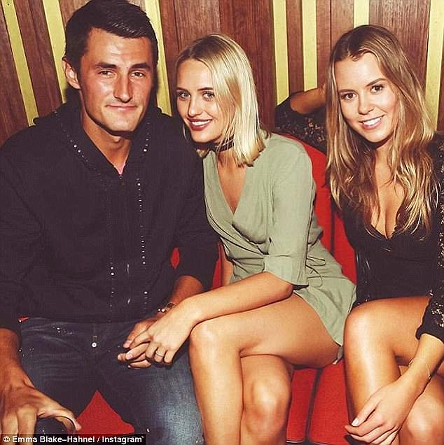 In the past 12 months Tomic has found love with model girlfriend Emma Blake-Hahnel (centre)