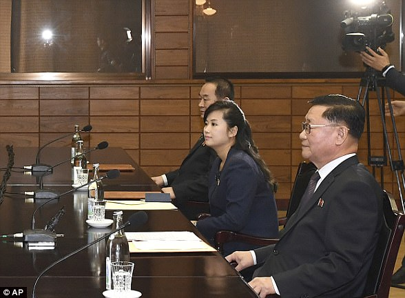 Hyon Song-wol (centre), leader of the popular Moranbong Band, was photographed alongside head of South Korea's delegation Kwon Hook Bong and the head of the North's team, Lee Woo-sung (right)