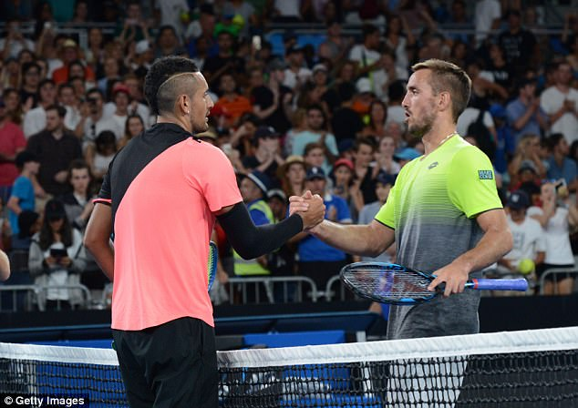 Kyrgios (pictured, left, with Viktor Triocki) described the second round match as 'tough' saying the distractions made him lose his rhythm