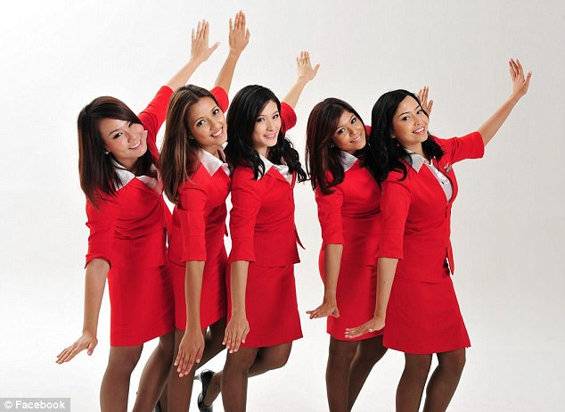 Dr Robertson said the dress of Air Asia flight attendants was'letting your reputation down'