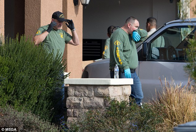 Riverside County Sheriff's Deputies searching the home of the Turpin family get some fresh air
