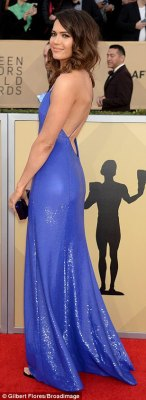 Beautiful:Newly engaged Mandy, 33, chose a strappy low-cut cobalt blue frock by Ralph Lauren, adding curly locks, nude lipstick and brown eye shadow