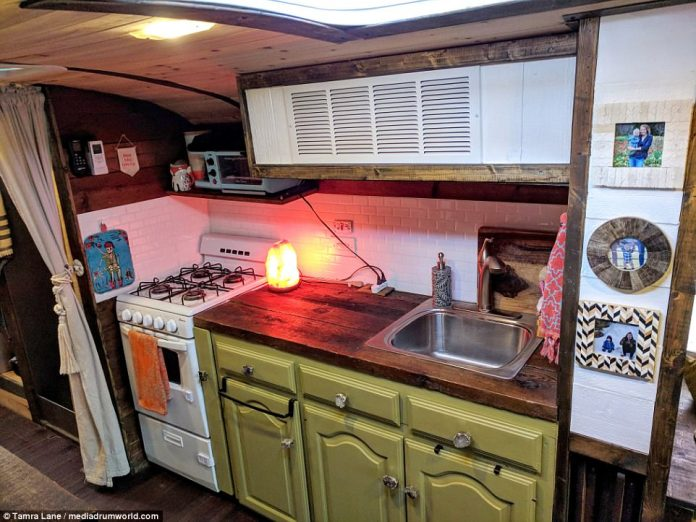 Eat your heart out, fellow travellers: A fitted kitchen - complete with sink and oven - allows the couple to cook together