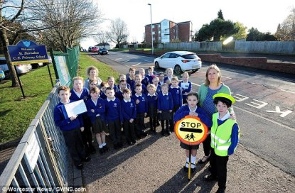 Road outside school is 'too dangerous' for a lollipop lady... but not for the children to cross