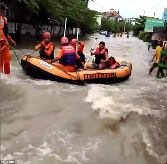 Rescue crews were called in with inflatable boats to help those stranded in flood waters