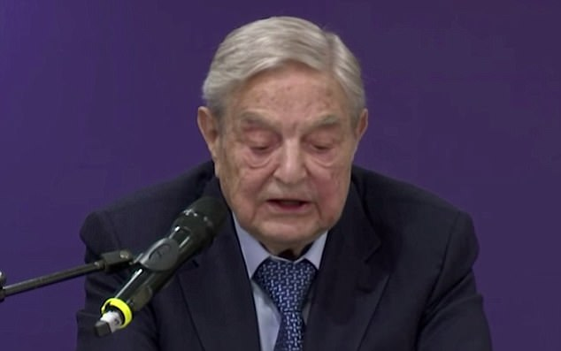 'But I regard it as a purely temporary phenomenon that will disappear in 2020, or even sooner.' Soros predicted a Democratic 'landslide' in the 2018 elections. Soros is pictured at the dinner giving his speech on Thursday