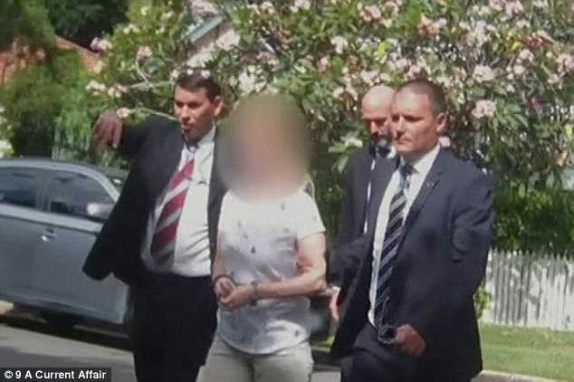 Police claim Erin was either dead or dying of an oxycodone overdose when the family left her at their Gold Coast home (pictured is Maree Crabtree in handcuffs being escorted from her home by police detectives)