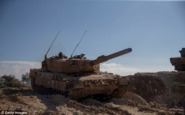 A Turkish tank is seen at Burseya Mountain. Turkish forces have been on the offensive since January 20
