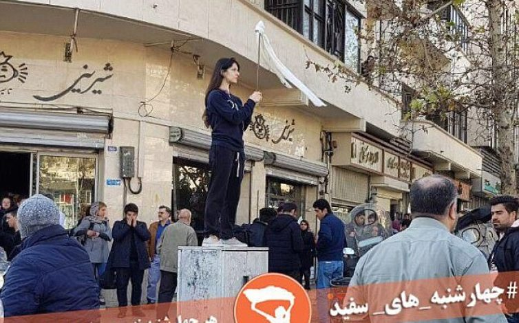 The original: Vida Movahed, 31, was arrested after taking off her hijab in public and standing on a telecoms box in Tehran in December - inspiring others to do the same