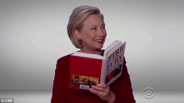 Happy Hil:In the segment at the Grammys (above), Clinton had a giant grin as she read a passage about President Trump's 'longtime fear of being poisoned'