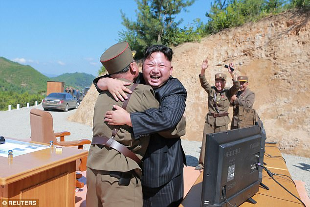 Pompeo said: ¿We talk about him having the ability to deliver a nuclear weapon to the United States in a matter of a handful of months.' Pictured: Kim Jong-Un celebrating a missile launch last year